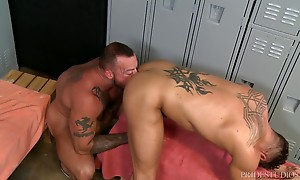 Sean bends Bryce over revealing his smooth hole and he buries his face deep between his cheeks and lubes it up for hi throbbing cock. Sean pushes his dick deep into Bryce who can barely handle it but Sean starts out slow and eventually is fucking him hard